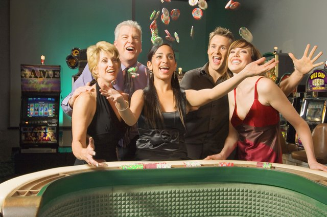 Woman tossing betting chips in celebration