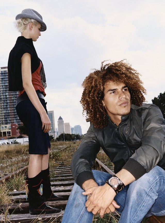Funky Twentysomething Man and Woman on an Urban Railway Track