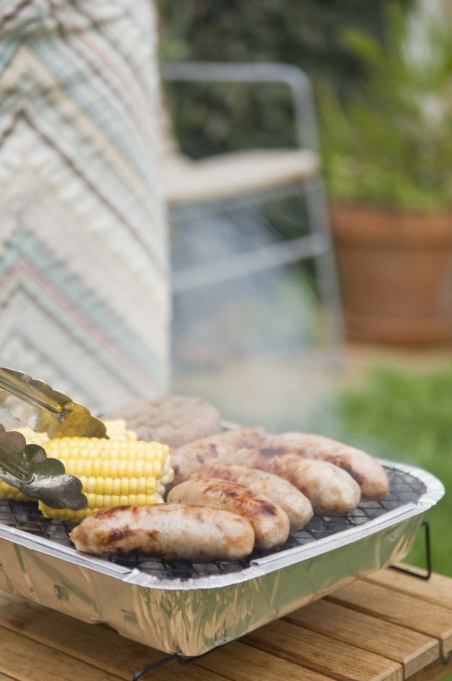 Grilling bratwursts and corn-on-the-cob