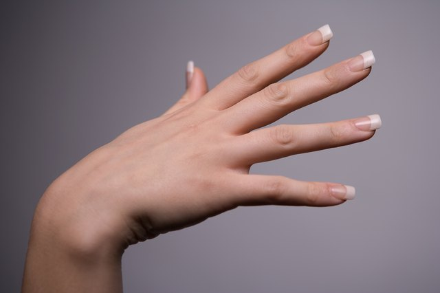 Woman showing manicured hand