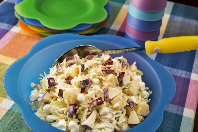 Bowl of coleslaw with apples, marshmallows and pineapple