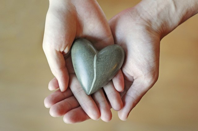 Couple hands holding a heart