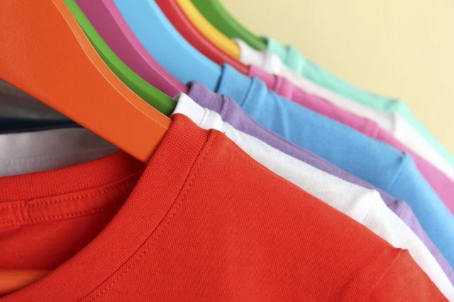 Different shirts on colorful hangers
