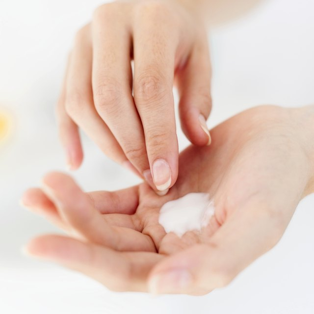 close-up of cream on a person's hand