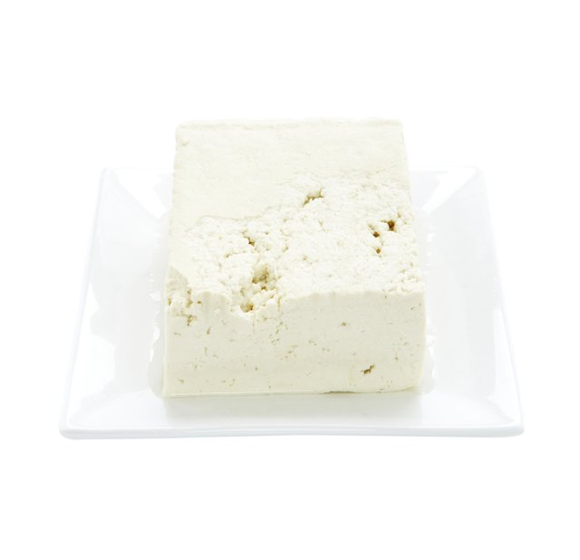 Tofu on plate on white background