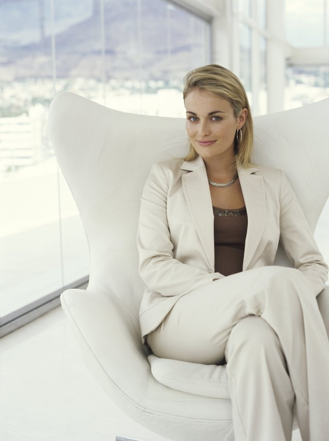Businesswoman sitting in armchair, portrait
