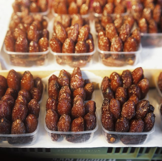 Dried dates in plastic punnets