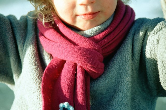 Child in red scarf