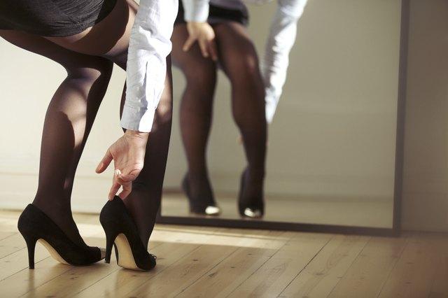 Woman adjusting high heels