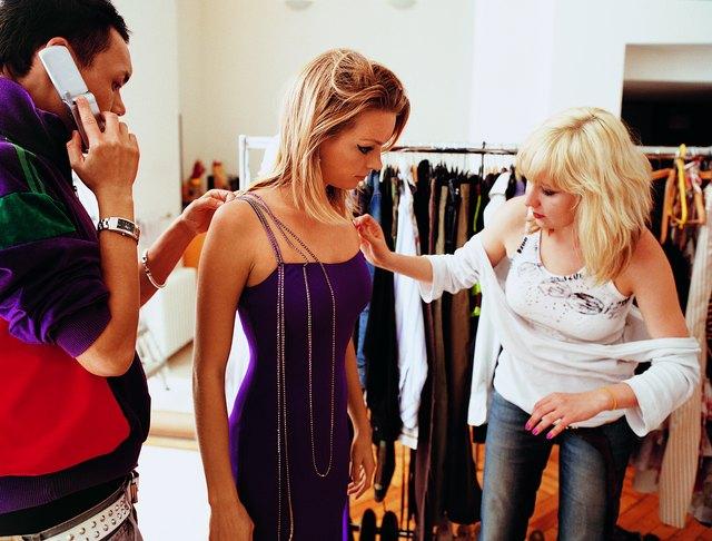 Stylists Dressing a Young, Female Fashion Model