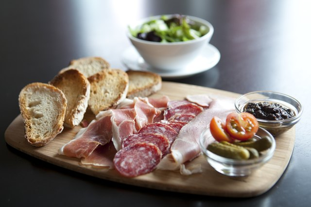 Antipasto plate with bread and smallgoods