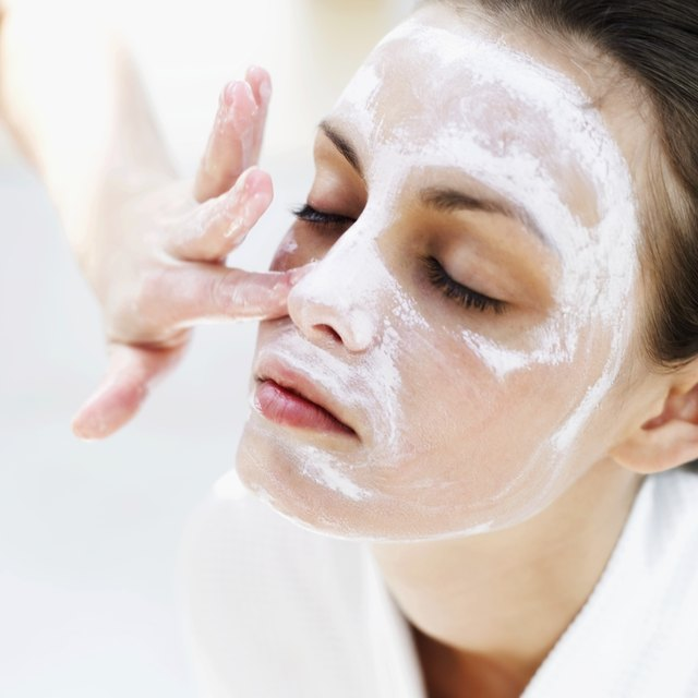 close-up of a woman applying face pack