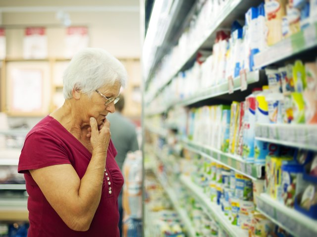 Senior woman choosing a dairy products at supermarket