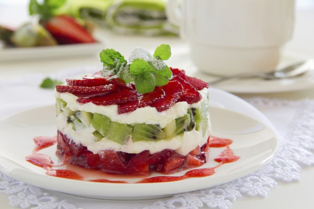Summer dessert with strawberries, kiwi and vanilla cream.