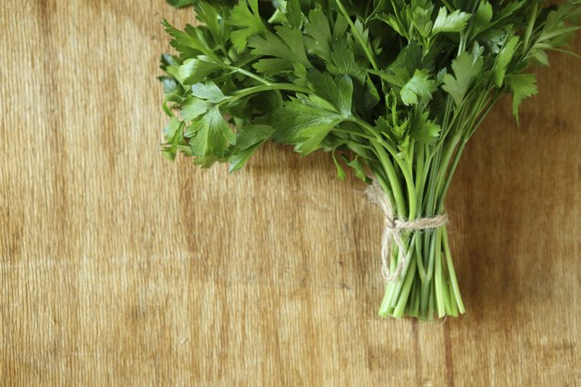 bundle of fresh herbs on a wooden surface