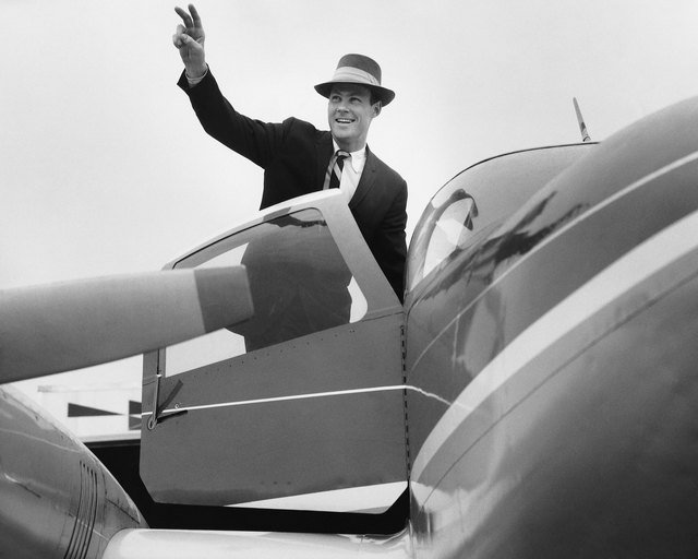 Man waving, getting in plane