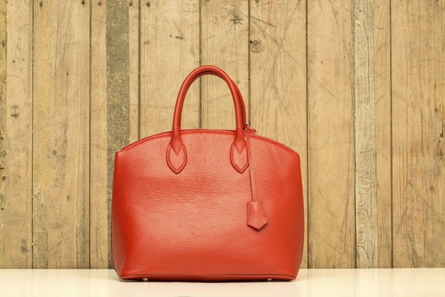 red purse on wood background