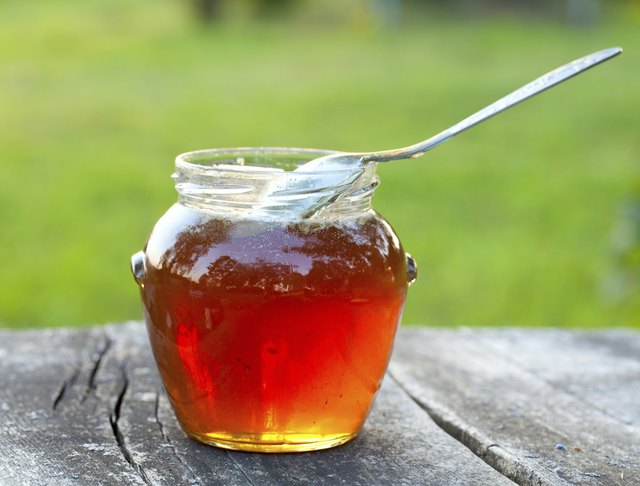 honey on wooden garden table