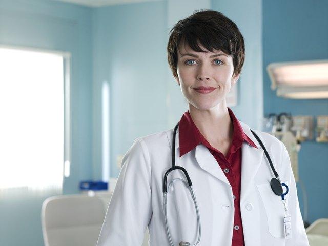 Female doctor in hospital room, portrait