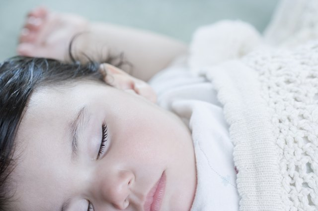 Close up of Hispanic baby sleeping
