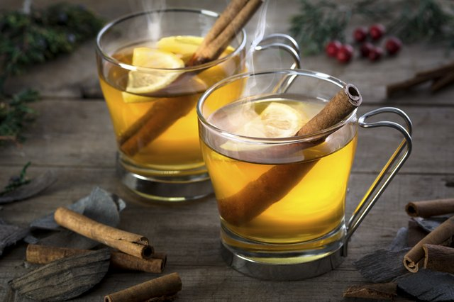 Two Hot Toddy Cocktail Drinks with Cinnamon and Lemmon