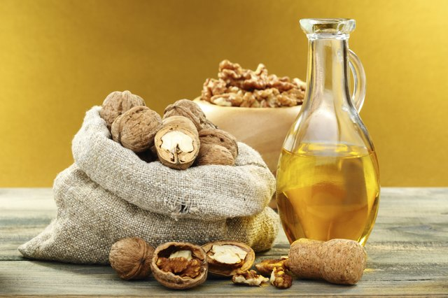 Walnut oil in bottle and nuts.