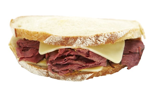 Pastrami sandwich on white background
