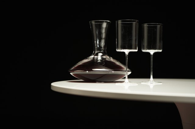 Decanter of red wine and two wineglasses on table