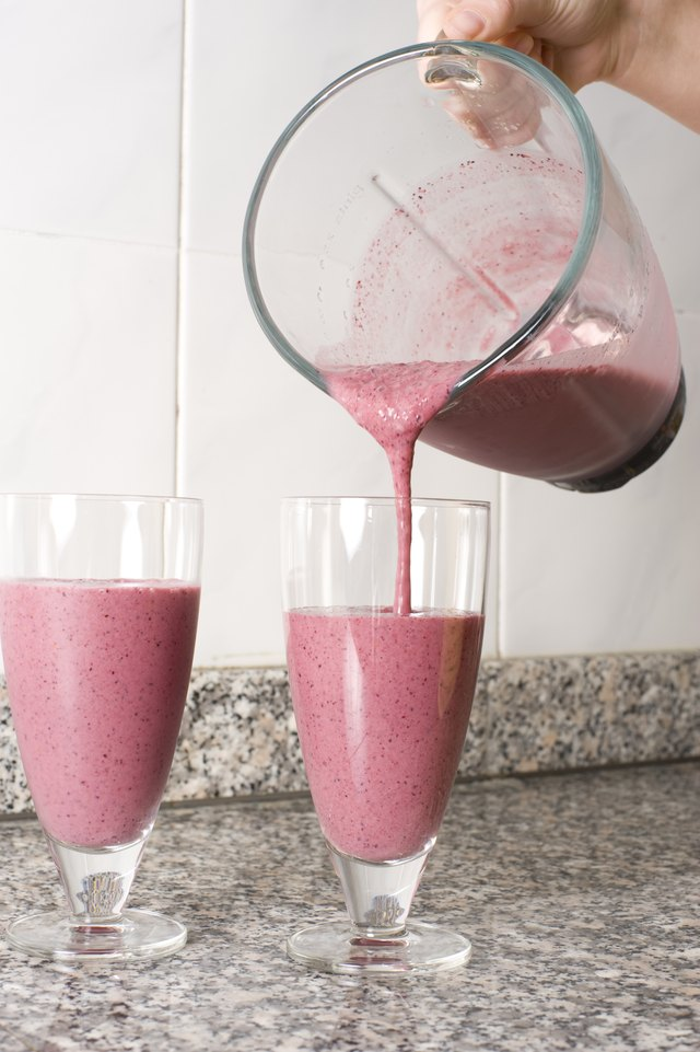 Preparing mixed berry smoothies