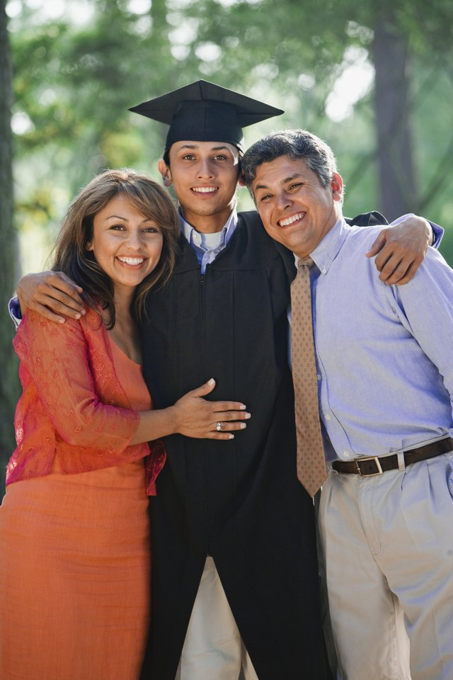 Proud parents with smiling graduate