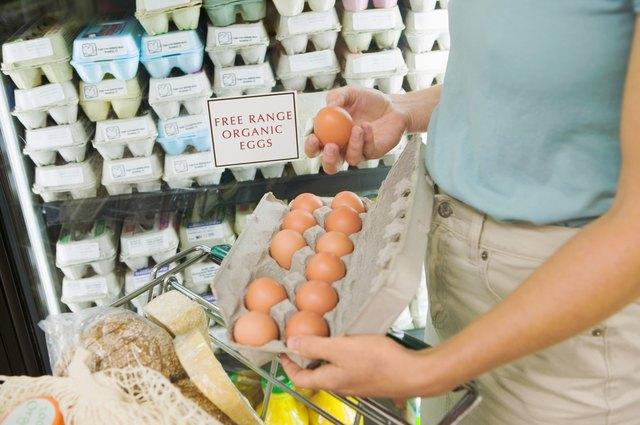 Person holding carton of organic eggs