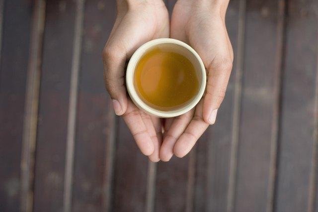 Woman's hands holding tea