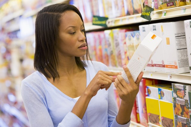 Female shopper checking food labelling