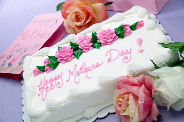 Sheet cake with words Happy Mother's Day!, card and flowers