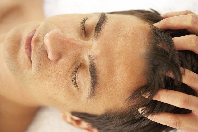 Therapist massaging man's scalp