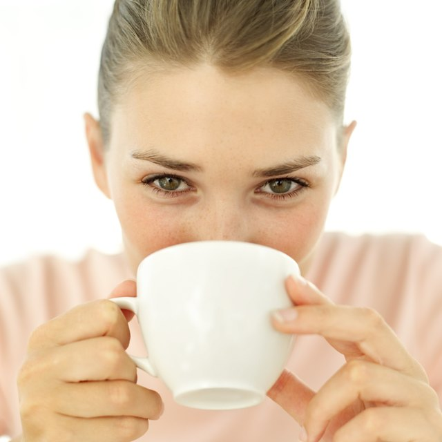 close-up of a woman drinking from a cup