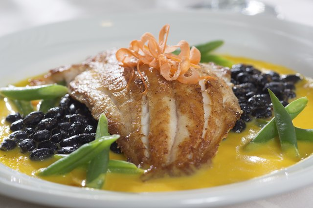 Fresh white fish served with black beans