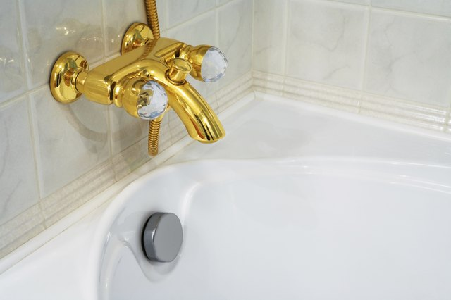 faucet and white bath