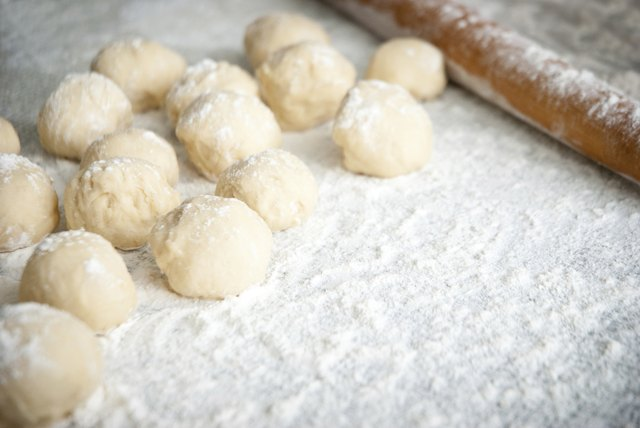 Prepared dough in ball shape on silver tray