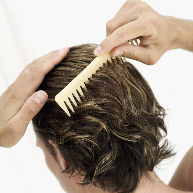 Person combing hair with comb