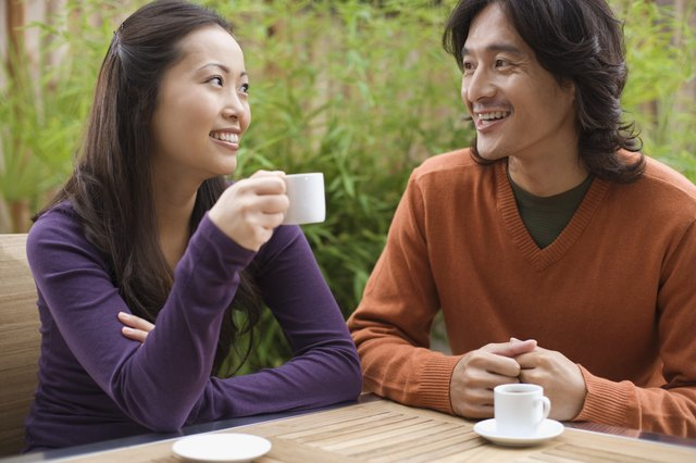 Smiling couple with espresso