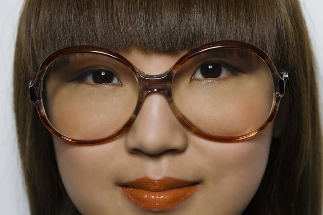 Beautiful Asian hipster with oversized glasses