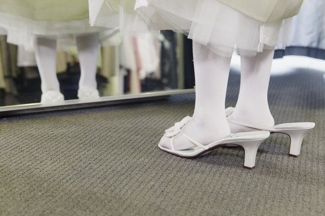 Flower girl trying on large shoes