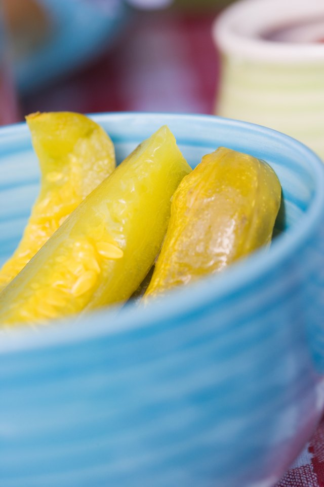 Close-up of bowl of pickles on picnic table