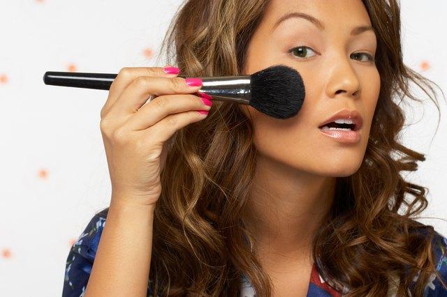 Woman powdering her cheeks