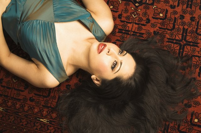 Woman with Beautiful Hair Lying Down