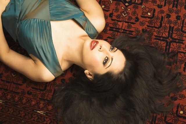 Woman with Beautiful Hair Lying Down