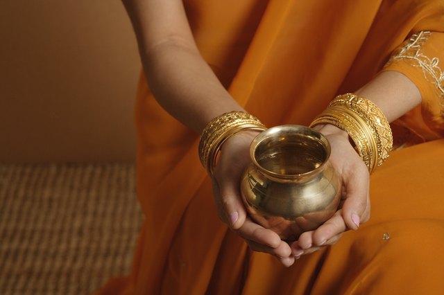 Woman holding metal bowl