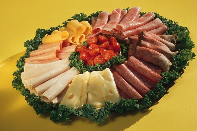 Platter of assorted cheeses and meats with garnish