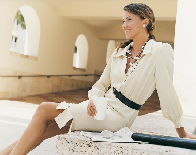 Businesswoman Relaxing Sitting on a Wall